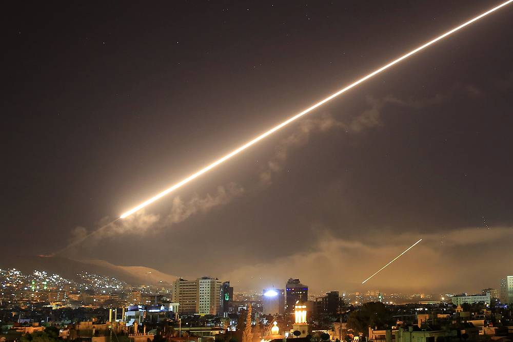 Surface-to-air missile blaze over Damascus' skies as the US-led coalition targets different parts of the Syrian capital, Damascus, April 14