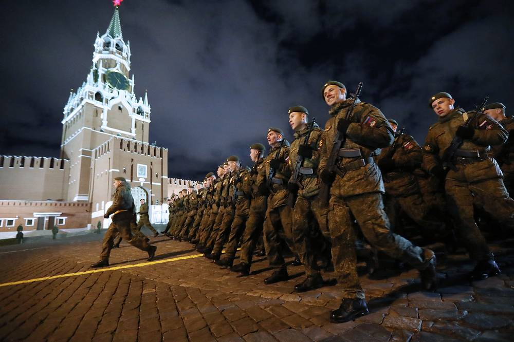 Servicemen march in formation in Moscow's Red Square during a night rehearsal of a Victory Day military parade commemorating the 73rd anniversary of the victory in the Great Patriotic War, the Eastern Front of World War II