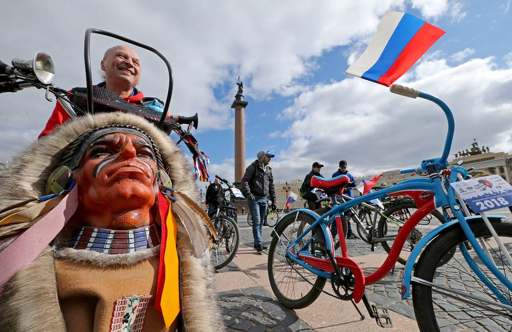 People ride bicycles during the opening of the biking season in Palace Square, Saint Petersburg, April 22