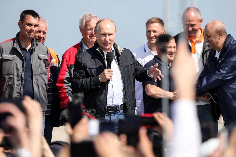 Russia's President Vladimir Putin speaks at the opening ceremony of a road section of the Kerch Strait Bridge