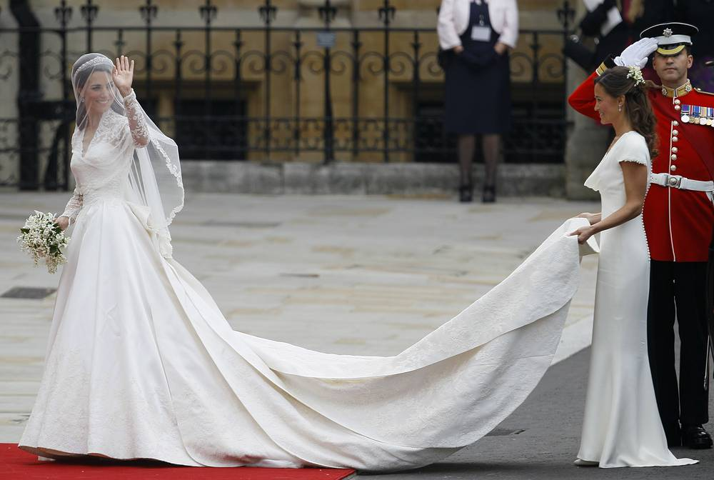 Catherine, Duchess of Cambridge, accompanied by maid of honour Pippa Middleton as they arrive at Westminster Abbey at the Royal Wedding in London, April 29, 2011