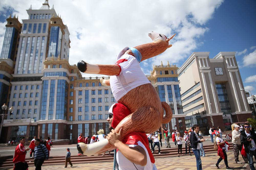Football fan carries a toy lama in a street ahead of Group C match between Peru and Denmark