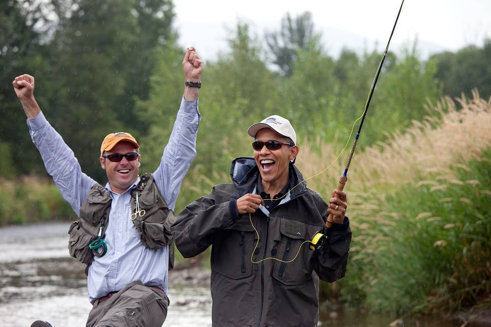 Local fishing guide reacts as former US president Barack Obama almost hooks a trout on the East Gallatin River near Belgrade, 2009