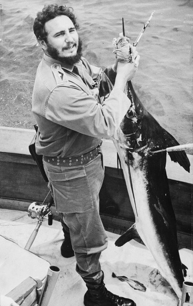 Cuba's leader Fidel Castro smiles after reeling in a 54 pound marlin fish at the annual Hemingway fishing tournament in Havana, Cuba, 1960
