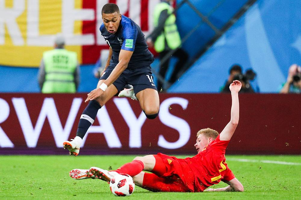 France's Kylian Mbappe and Belgium's Kevin De Bruyne in the 2018 FIFA World Cup Semi-final match between France and Belgium at Saint Petersburg Stadium