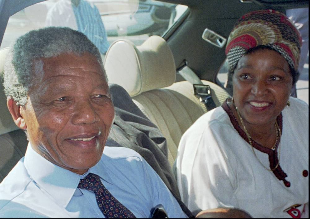 Nelson Mandela and his wife Winnie at Cape Town's airport prior to a flight to Johannesburg, 1990, the day after his release from prison