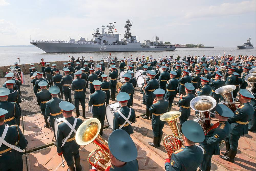 A military band performs as the Admiral Gorshkov frigate takes part in the dress rehearsal of a naval parade marking the Day of the Russian Navy in Saint Petersburg
