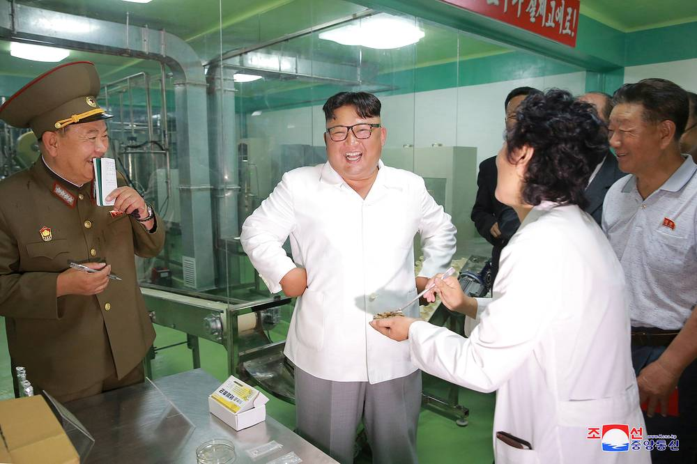 North Korean leader Kim Jong Un inspects a factory in this undated photo released by North Korea's Korean Central News Agency (KCNA) on July 24