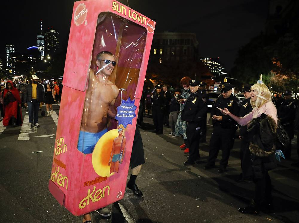 People dressed up in costumes march during the 45th annual Greenwich Village Halloween Parade in New York