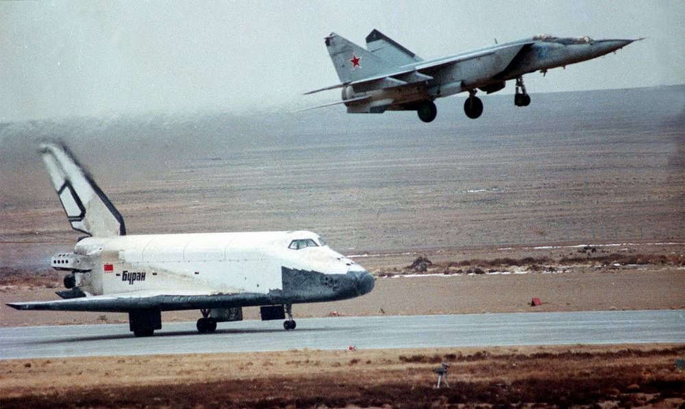 Mig-25 plane piloted by Magomet Tolboyev accompanies Buran shuttle during its landing, November 15, 1988