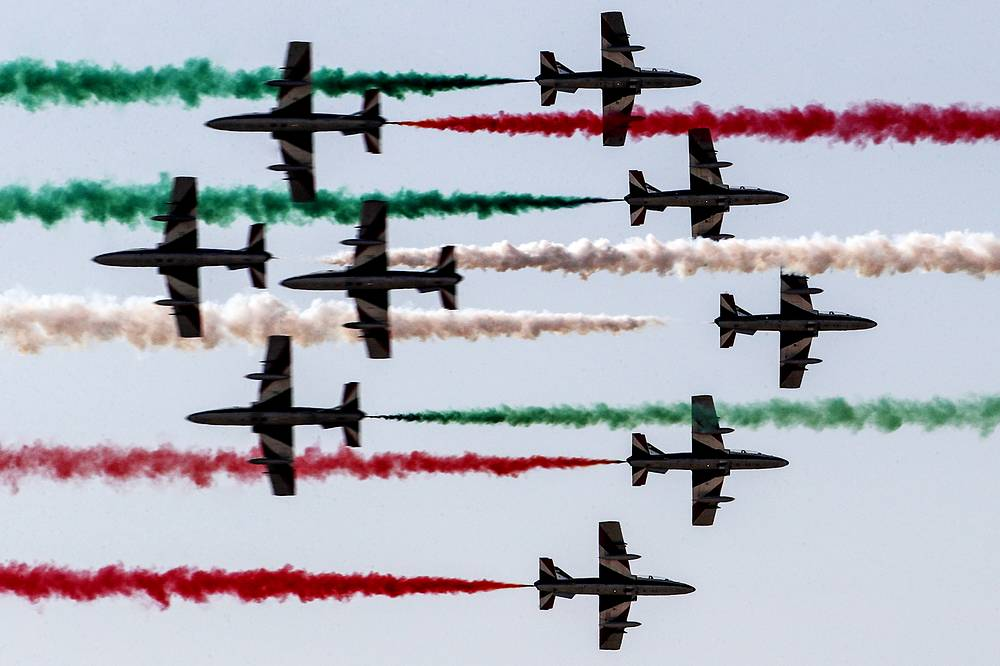 Aermacchi MB-339 jets from the Italian Frecce Tricolori aerobatic team glide past one another