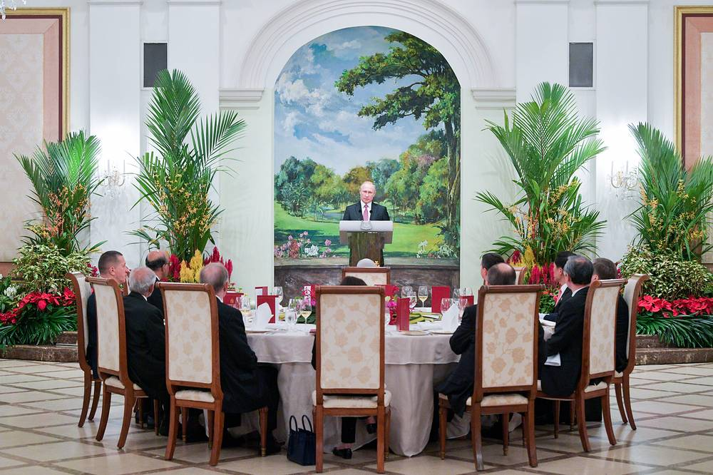 Russian President Vladimir Putin speaks at a reception given at the Istana to honor his visit to Singapore, November 13