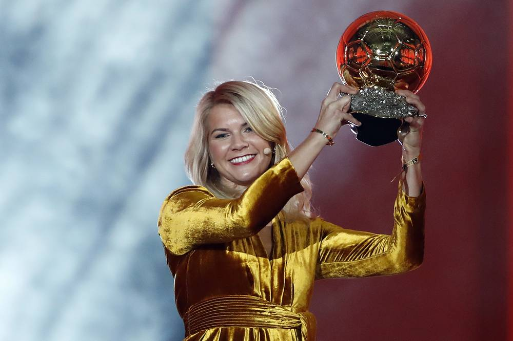 Olympique Lyonnais' Ada Hegerberg with the Women's Ballon d'Or award. This year, the Ballon d'Or, Golden Ball for the best player of the year was given to both a woman and a man
