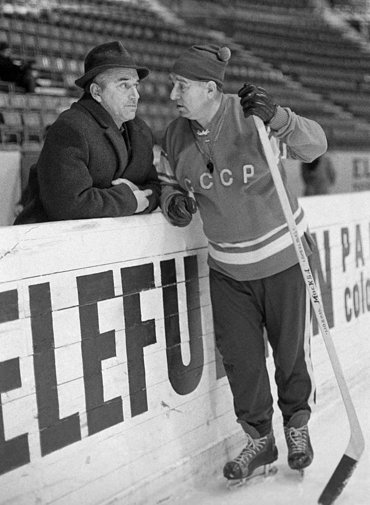 Coaches of Soviet national ice hockey team Arkady Chernyshov and Anatoly Tarasov having a conversation during the 1969 IIHF World Ice Hockey Championship in Stockholm, 1969