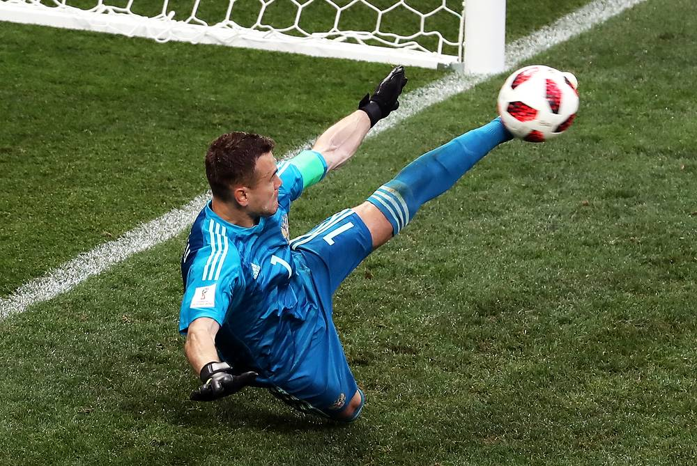 Russia's goalkeeper Igor Akinfeev saves a penalty in 2018 FIFA World Cup Round of 16 football match against Spain at Luzhniki Stadium. Team Russia won the game on penalties 4:3