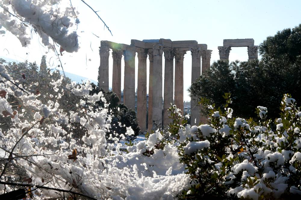 The Temple of Olympian Zeus covered with a snowy facade in central Athens, January 8