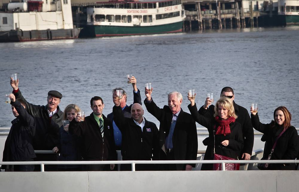 "Captain Chesley ""Sully"" Sullenberger, pilot who safely glided US Airways Flight 1549 to a water landing 5 years ago, with survivors and rescuers marking the anniversary of the event, January 15, 2014"