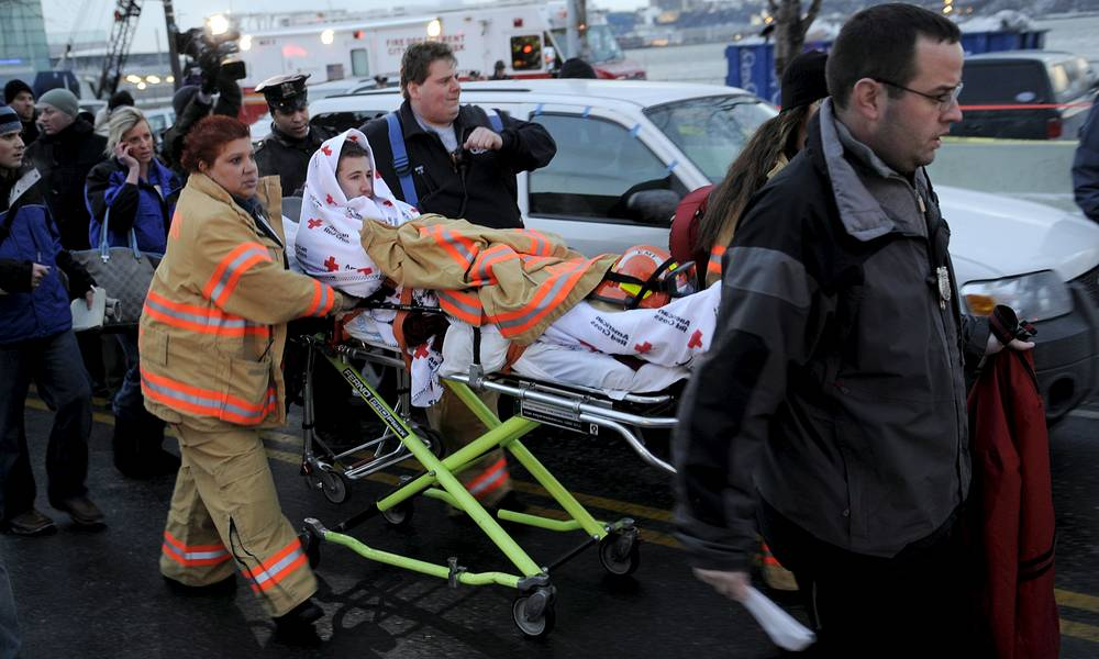 A crash victim from the US Airways Airbus A320 flight number 1549 is taken to into an ambulance on the West Side Highway at 40th Street, 15 January, 2009