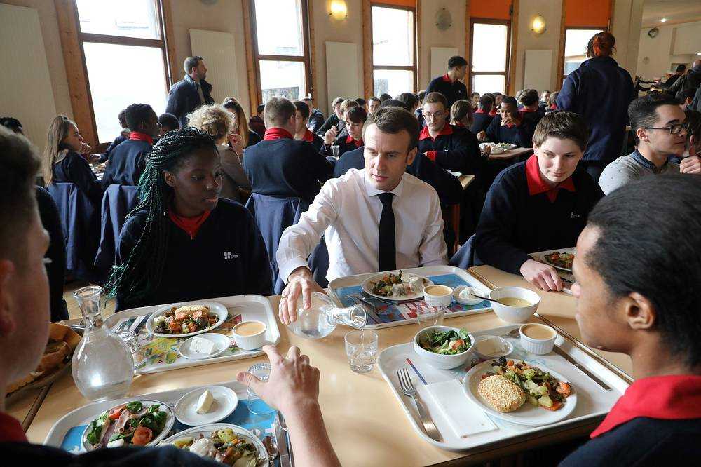 French President Emmanuel Macron has lunch with students at a school canteen in Etang-sur-Arroux, France, Febuary 7