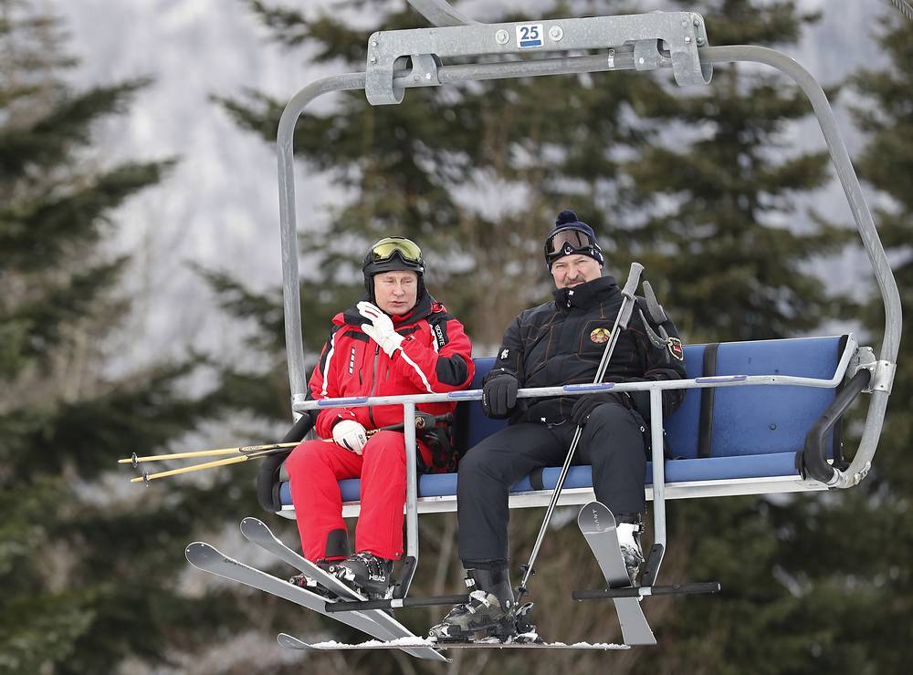 Russian President Vladimir Putin and Belarusian President Alexander Lukashenko take a ski lift to the slopes to enjoy some mountain skiing at the Gazprom Mountain Resort in Sochi, February 13