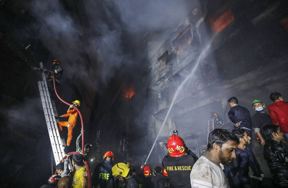 Firefighters work at the site of the fire in Dhaka, Bangladesh