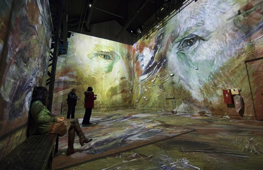 Visitors look at works by Dutch painter Vincent Van Gogh projected onto walls, as part of the 'Van Gogh: Starry Night', by artistic director Gianfranco Iannuzzi, at the Atelier des Lumieres in Paris, February 21
