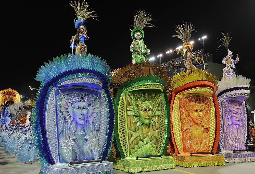 Dancers from the Dragoes da Real samba school perform on a float during a Carnival parade in Sao Paulo