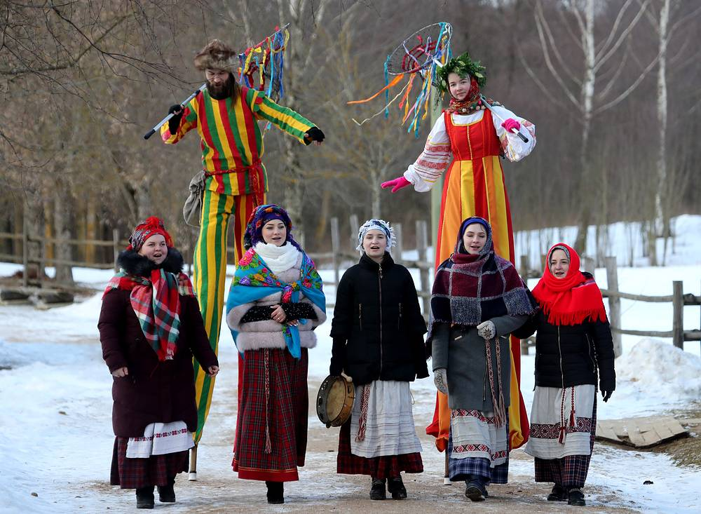 People dressed in traditional clothes sing and dance during Maslenitsa celebrations in the village of Ozertso, Belarus