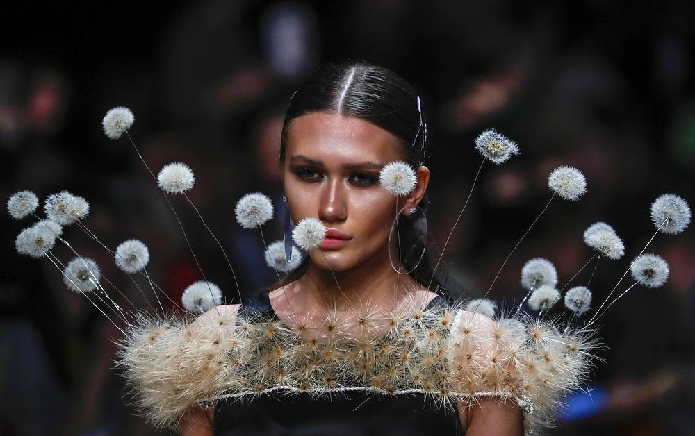 A model presenting a creation by Russian designer Svetlana Evstigneeva during the Mercedes-Benz Fashion Week, in Moscow, April 3