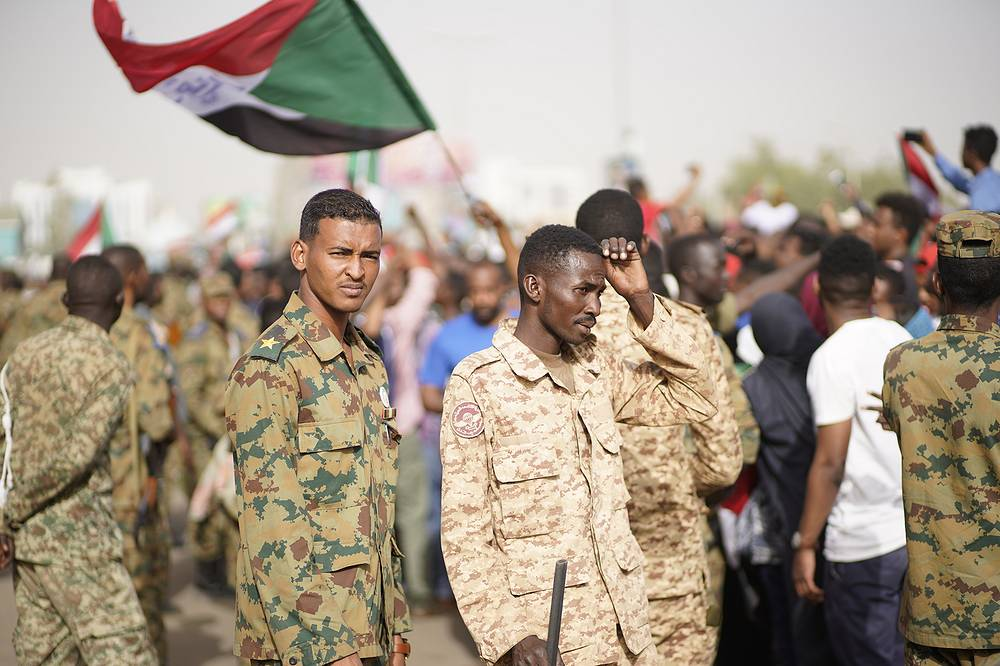 Demonstrators waiting for an announcement outside the Sudanese Army headquarters in Khartoum
