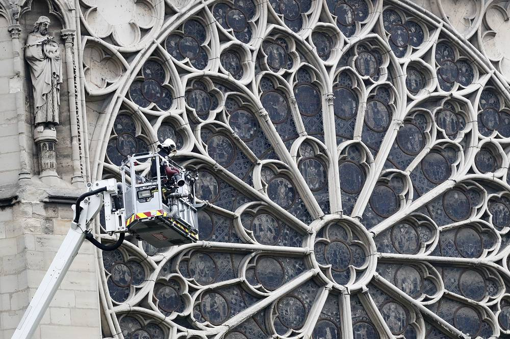 The top part of the spire and the clock of the Notre Dame de Paris cathedral have collapsed as a result of the fire