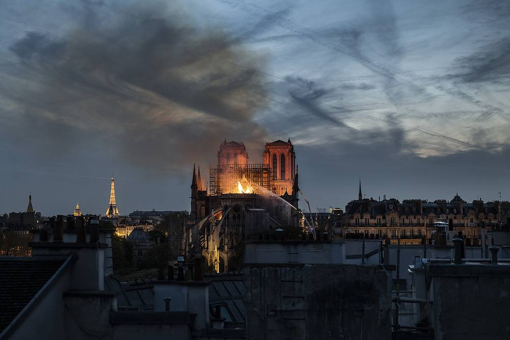 Flames and smoke are seen billowing from the roof at Notre-Dame Cathedral in Paris, April 15. A fire broke out at Paris' iconic Notre Dame Cathedral on April 15 at around 7 pm local time and quickly spread across the building, collapsing the spire