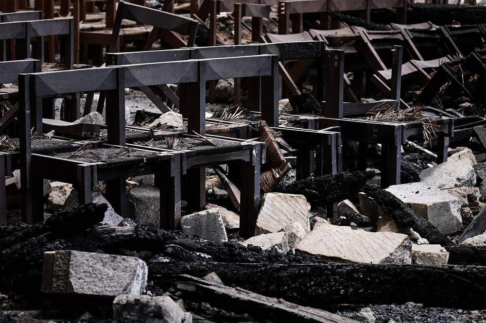 Damaged chairs and rubble in the Notre Dame de Paris Cathedral