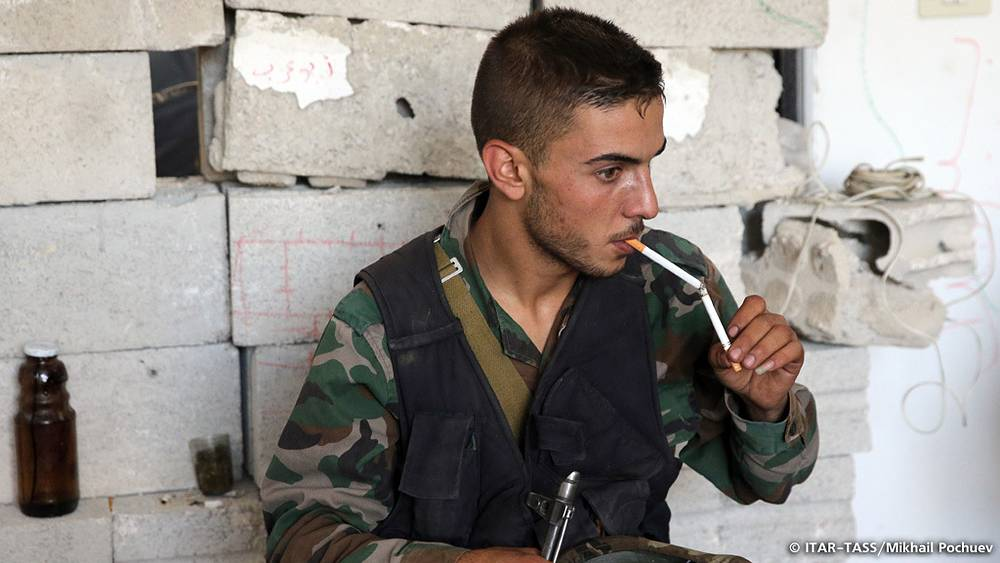 September 17. Soldier of the Syrian government lighting a cigarette in a house previously occupied by Al-Nusra Front militant group.