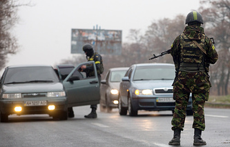 Ukrainian soldiers at a checkpoint