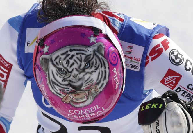 France's Marion Bertrand shows a tiger painting on her helmet at the Alpine skiing world championships in Austria, 2013