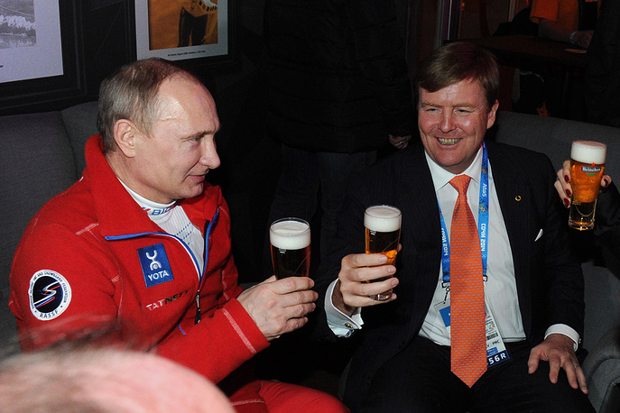 Russia's president Vladimir Putin (L) and King Willem-Alexander of the Netherlands (R) at the Holland Heineken House
