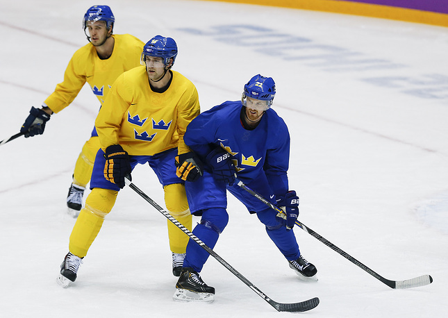 Sweden forward Daniel Sedin, right, jockeys for position against forward Patrik Berglund during a training session in Sochi