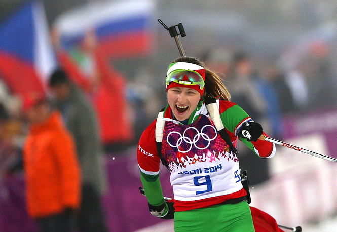 Biathlete Darya Domracheva of Belarus reacts as she wins the women's 10km pursuit