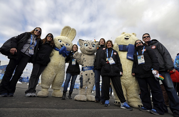 US national team members take photos with Olympic mascots
