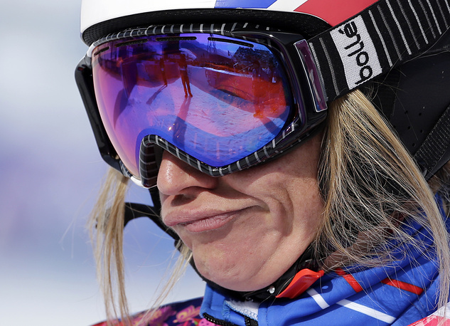 France's Deborah Anthonioz reacts after her seeding run during women's snowboard cross competition