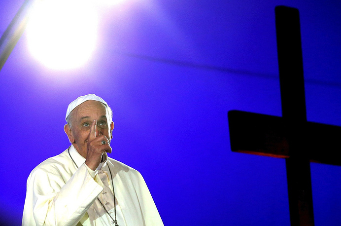 Pope Francis gestures at a mass at Copacabana beach in Rio de Janeiro