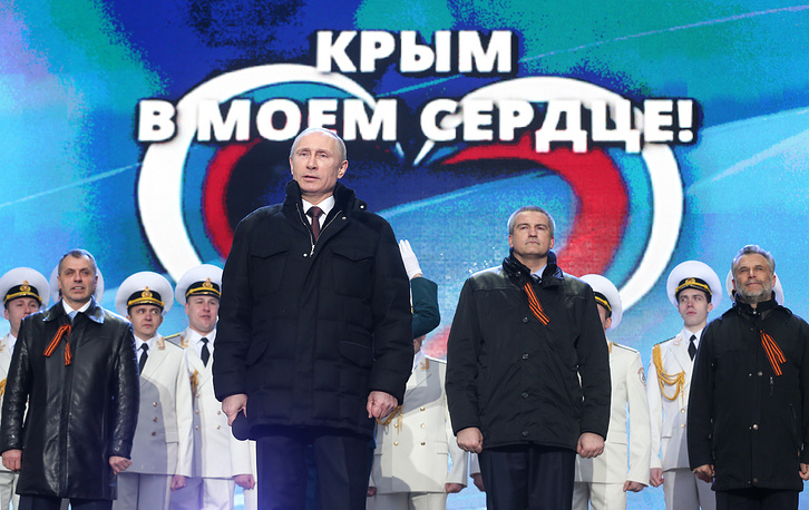 Russian President Vladimir Putin speaks at a rally celebrating Crimea and Sevastopol joining Russia on Red Square in Moscow