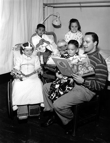 Brando reads a fairytale to children in a Los Angeles hospital in 1956