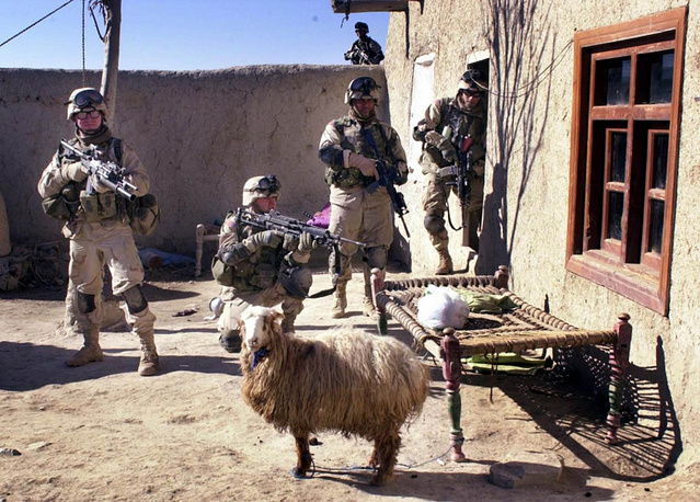 NATO heads the ISAF international security mission in Afghanistan in 2003. Photo: NATO soldiers search a village