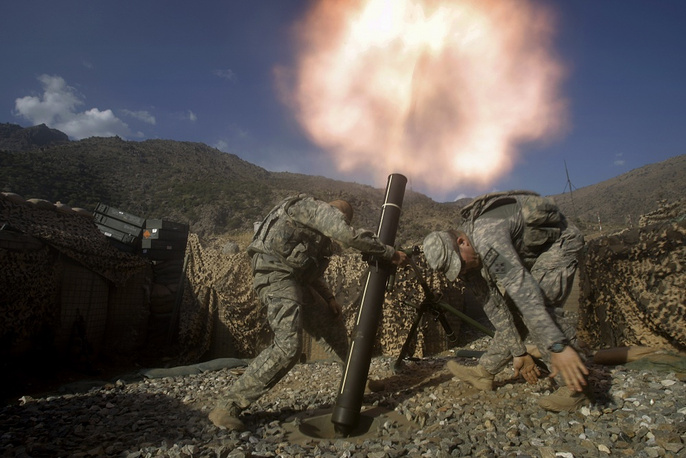 NATO heads the ISAF international security mission in Afghanistan in 2003. Photo: NATO soldiers firing a mortar in Kunar Province, Afghanistan
