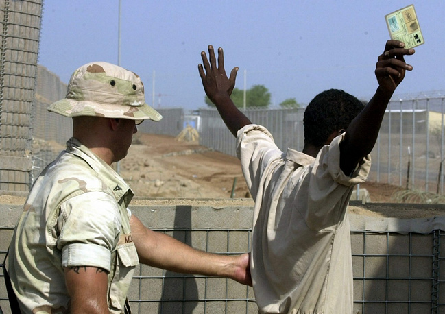 NATO has participated in operations at the coast of the African Horn since 2008. Photo: NATO officer searching a worker in Jibuti