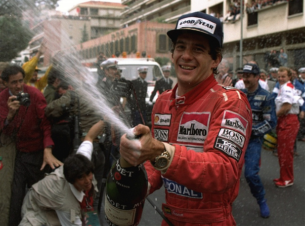Ayrton Senna sprays champagne on the photographers to celebrate his career's 30th victory at the Monaco Formula One Grand Prix in 1990