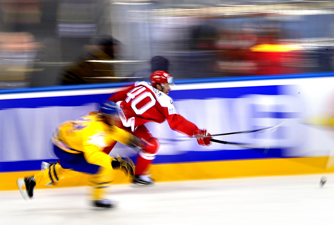 Jesper Christensen (R) of Denmark in action against Magnus Nygren (L) of Sweden