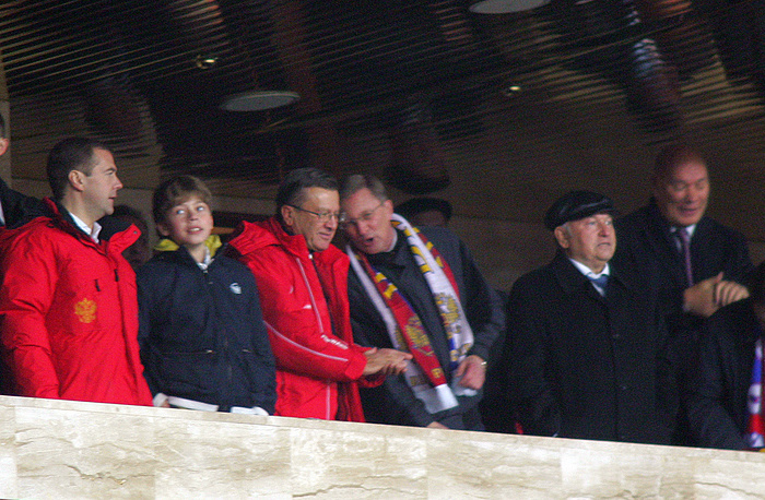 Russian Prime Minister Dmitry Medvedev and his only son Ilya (first and second left) attend a football match between Russia and England